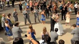 Groom Surprises Bride With Flash Mob